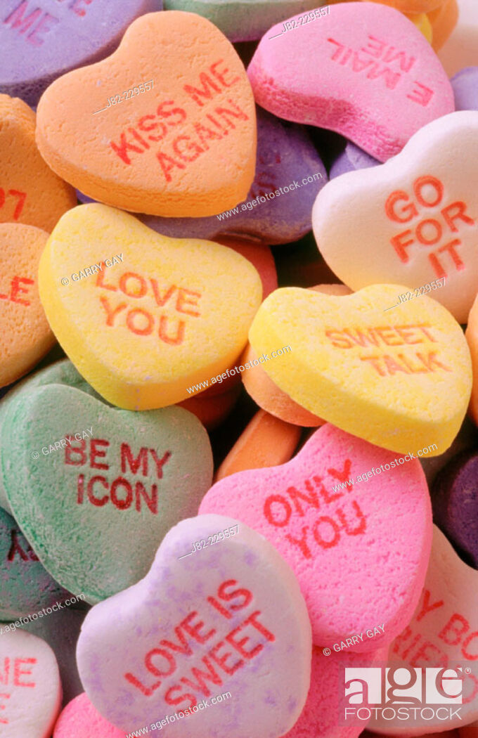 Stock Photo: Valentine candy hearts with messages on them.