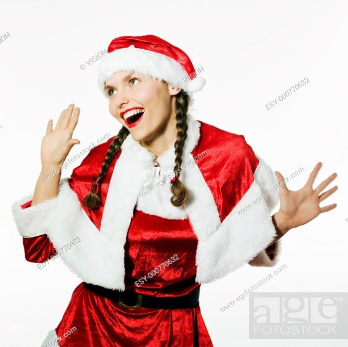 Stock Photo: young funny and expressive woman dressed as santa claus is doing her shopping.