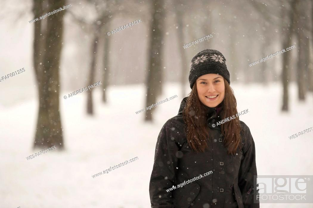 Stock Photo: Smiling young woman in winter.