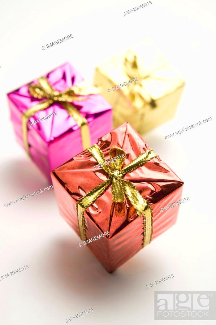 Stock Photo: Three gift packages.