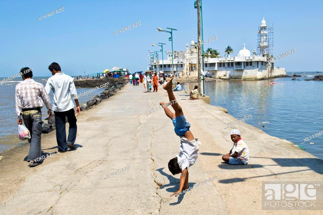 Stock Photo: Young street artist, Haji Ali Mosque, Mumbai, India.