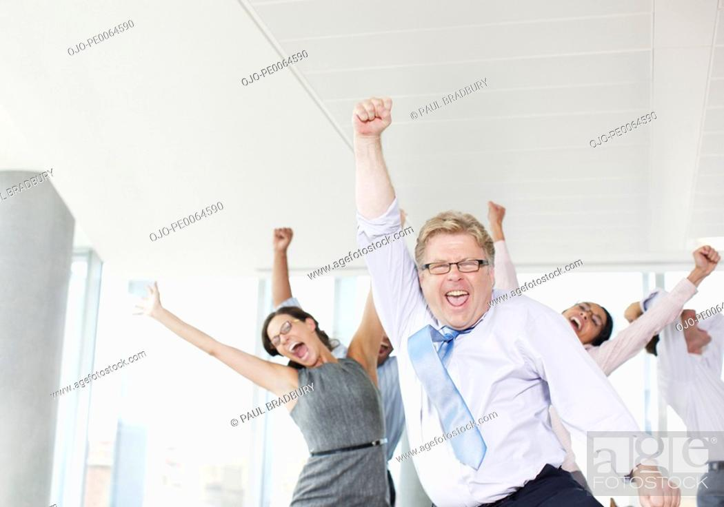Stock Photo: Businesspeople dancing in office.