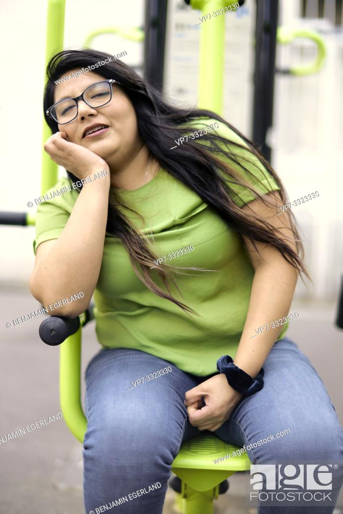 Stock Photo: weary woman catnapping, snoozing while sitting.