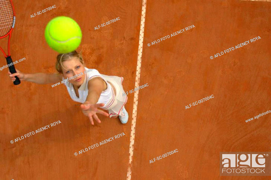 Stock Photo: Top View of Female Tennis Player Mid-Serve.
