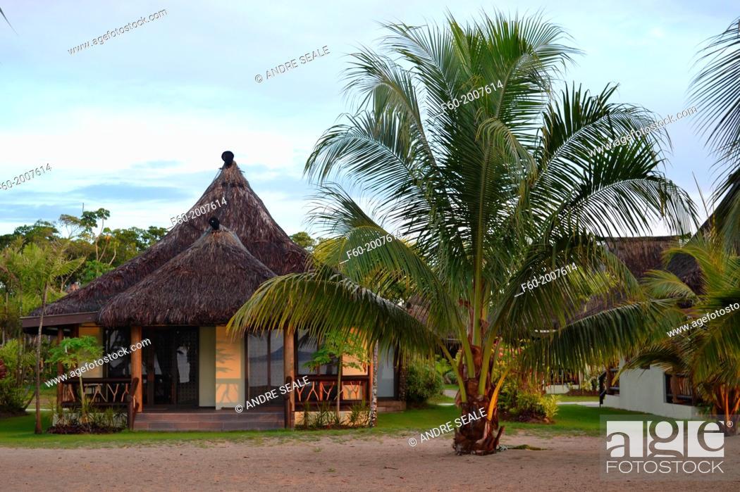 """Stock Photo: Beachfront resort bangalow, or """"""""bure"""""""", Pacific Harbour, Viti Levu, Fiji."""