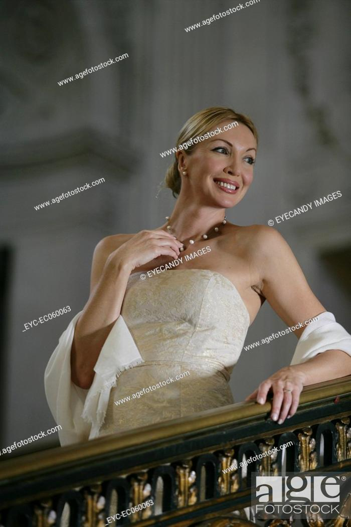 Stock Photo: Mature woman smiling on a staircase.
