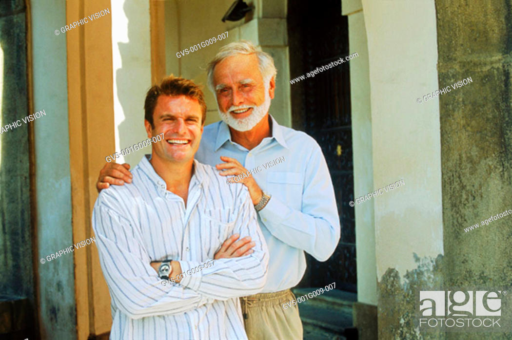 Stock Photo: Young man and elderly man smiling.