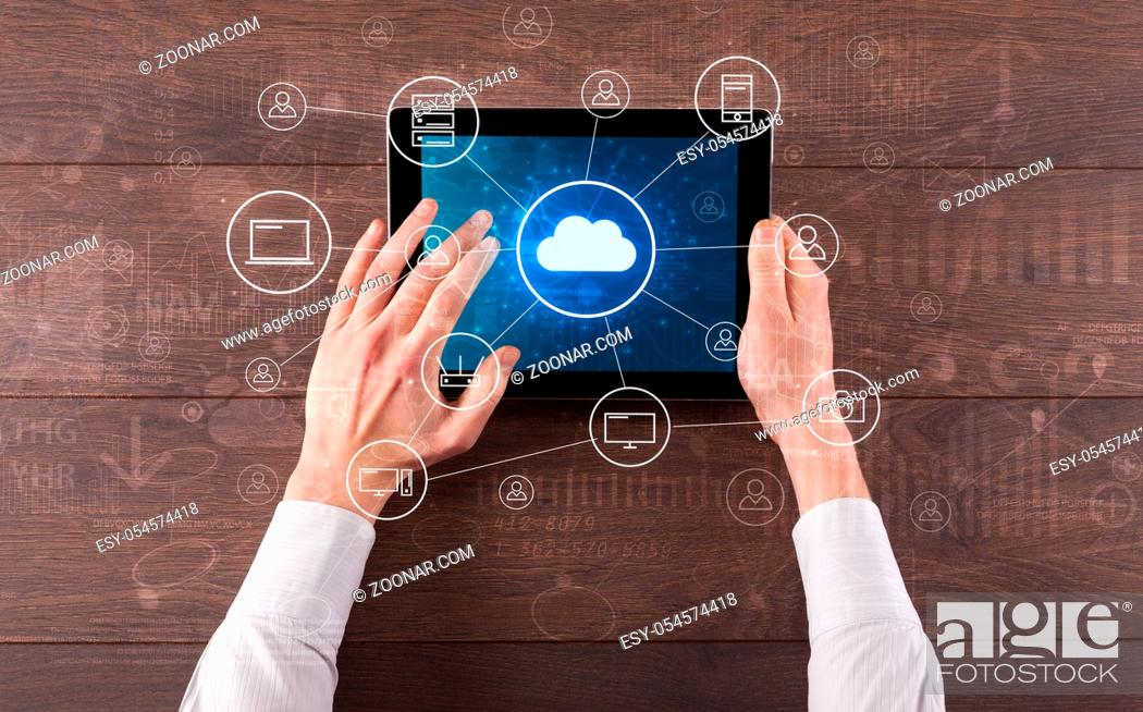 Stock Photo: Hand touching tablet with cloud computing and online storage concept.