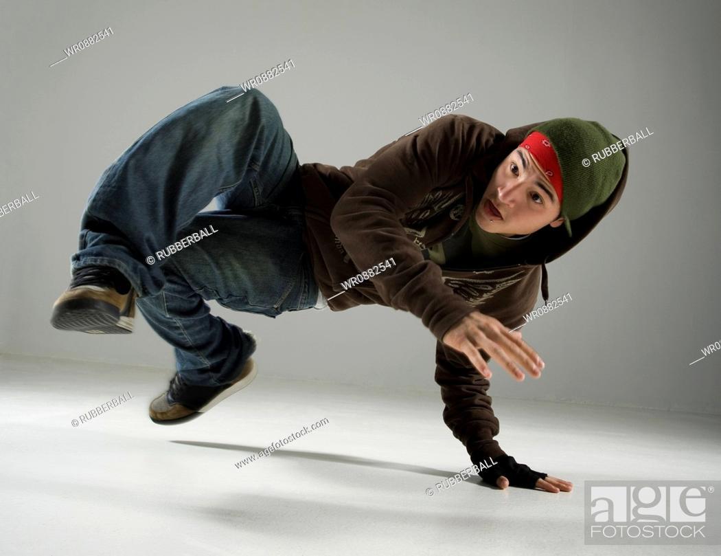 Stock Photo: Young man break dancing.