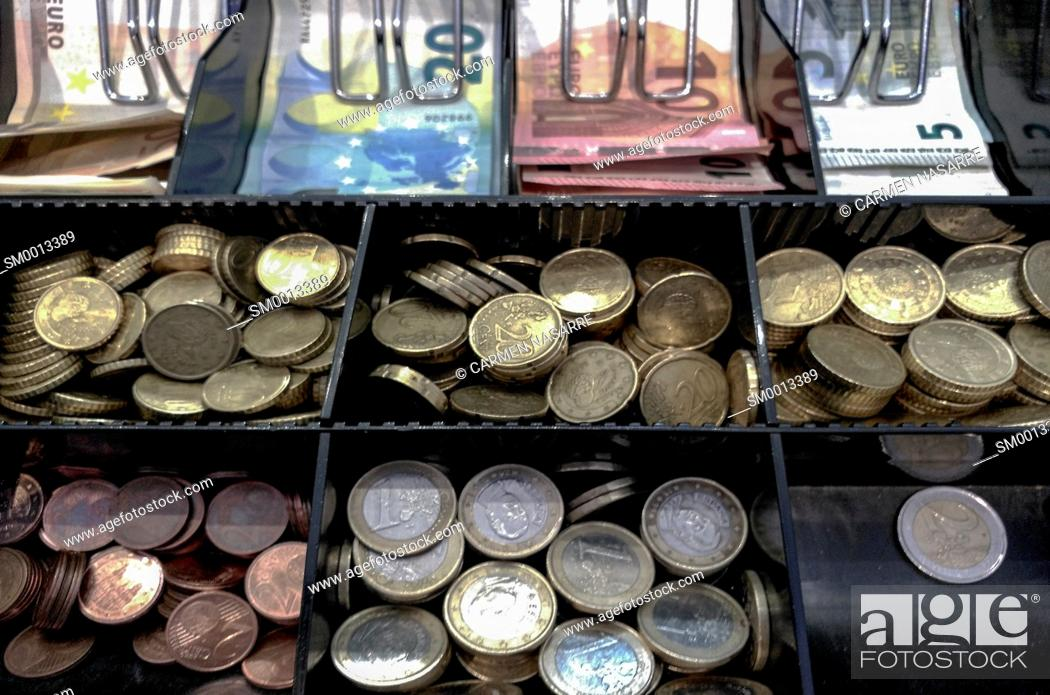 Stock Photo: Cash register with euro coins and banknotes in a store.
