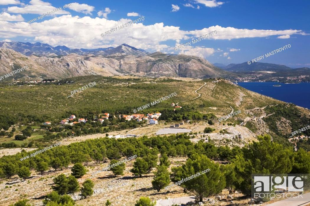 Stock Photo: Aleppo pine tree (Pinus halepensis) forest and mountain landscape with small village taken from Mount Srd; Dubrovnik, Dalmatia region, Croatia.