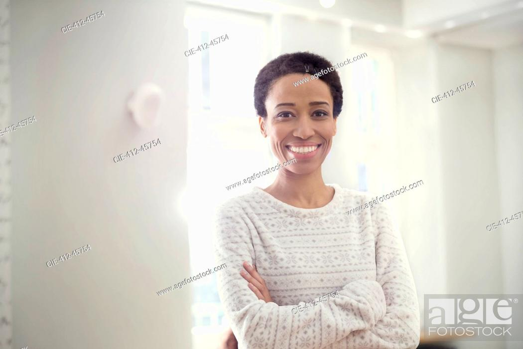 Stock Photo: Portrait confident, smiling woman with arms crossed.