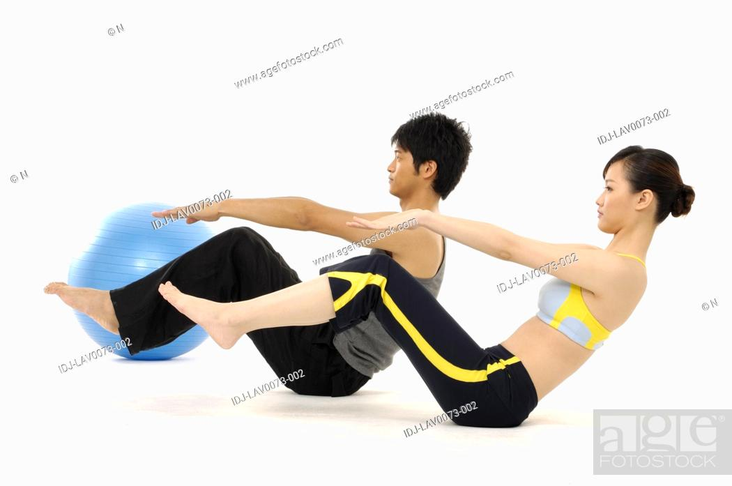 Stock Photo: Group of people doing fitness exercise with a ball.