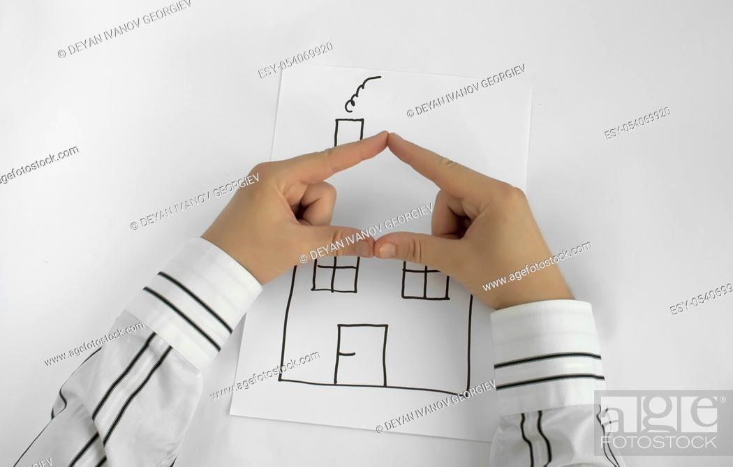 Stock Photo: Painted house and two hands for roof. White background.