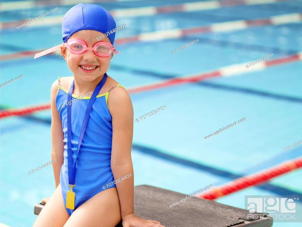 Stock Photo: Girl wearing swimming goggles by pool portrait.