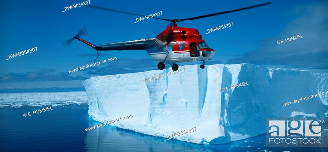 Imagen: russian MI 2 helicopter flying over table iceberg, Antarctica.