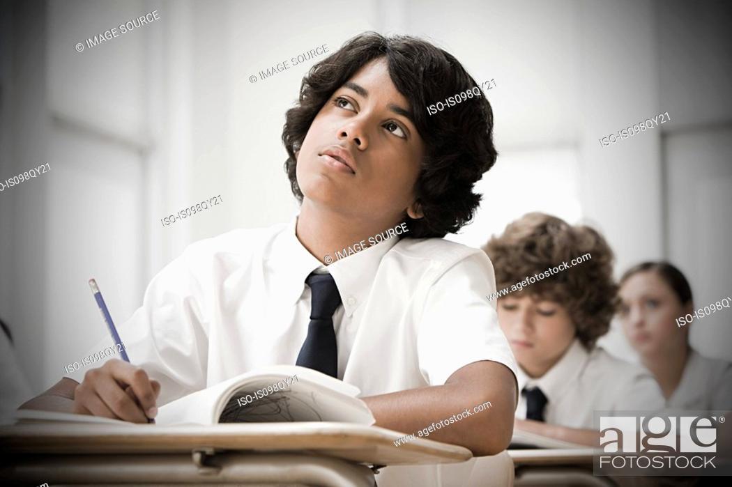 Stock Photo: School students in classroom.