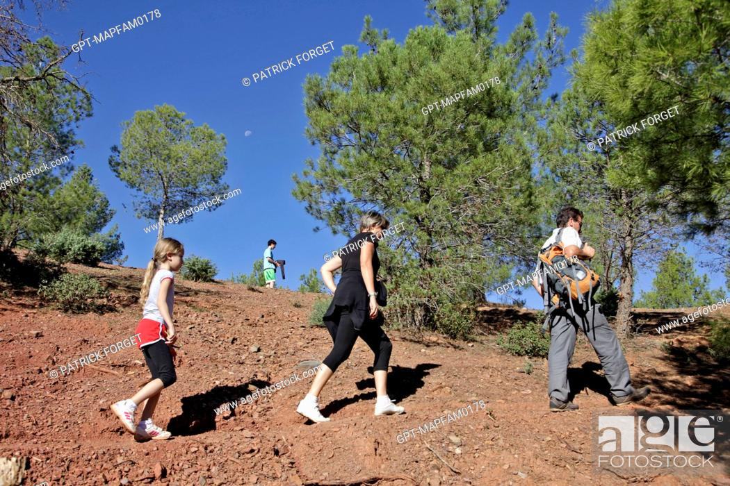Stock Photo: HIKING WITH A GUIDE ON THE DJEBEL KLELOUT MOUNTAIN, ONE OF THE ACTIVITIES AT THE DOMAINE DE TERRES D'AMANAR, TAHANAOUTE, AL HAOUZ, MOROCCO.