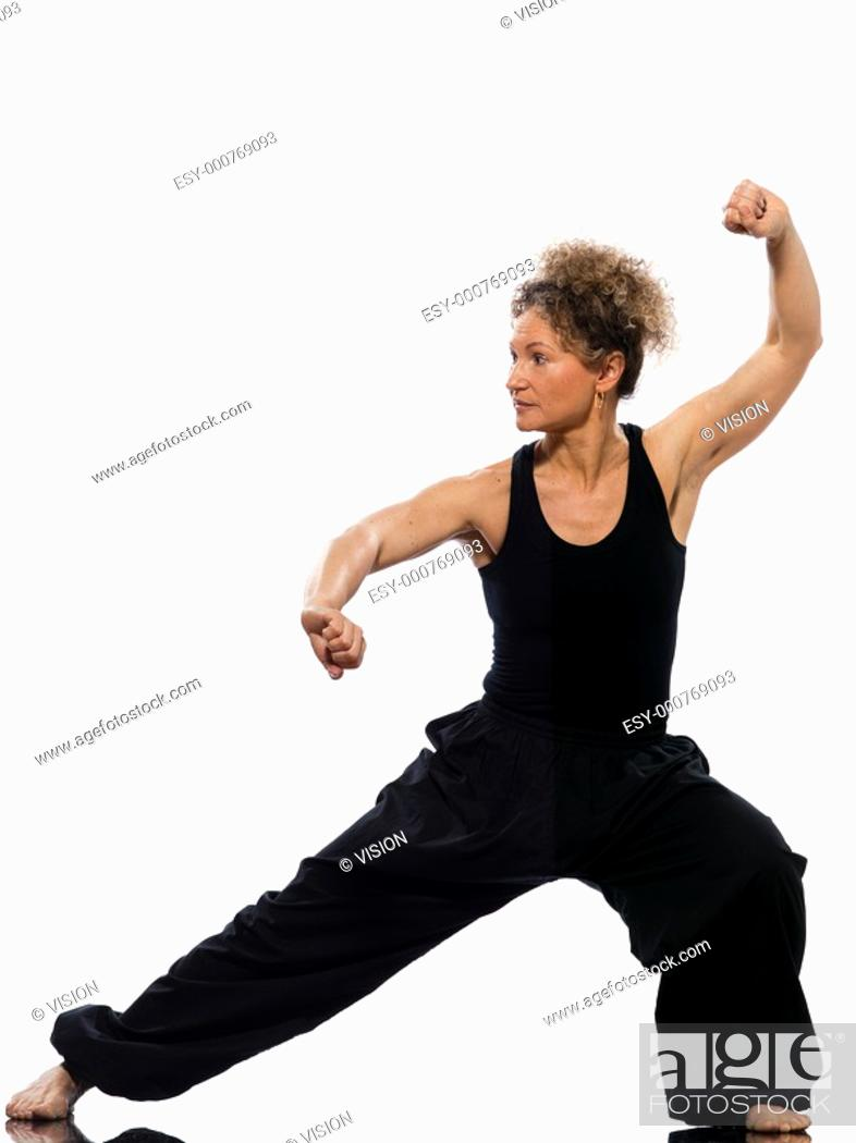 Stock Photo: mature woman praticing tai chi chuan in studio on isolated white background.