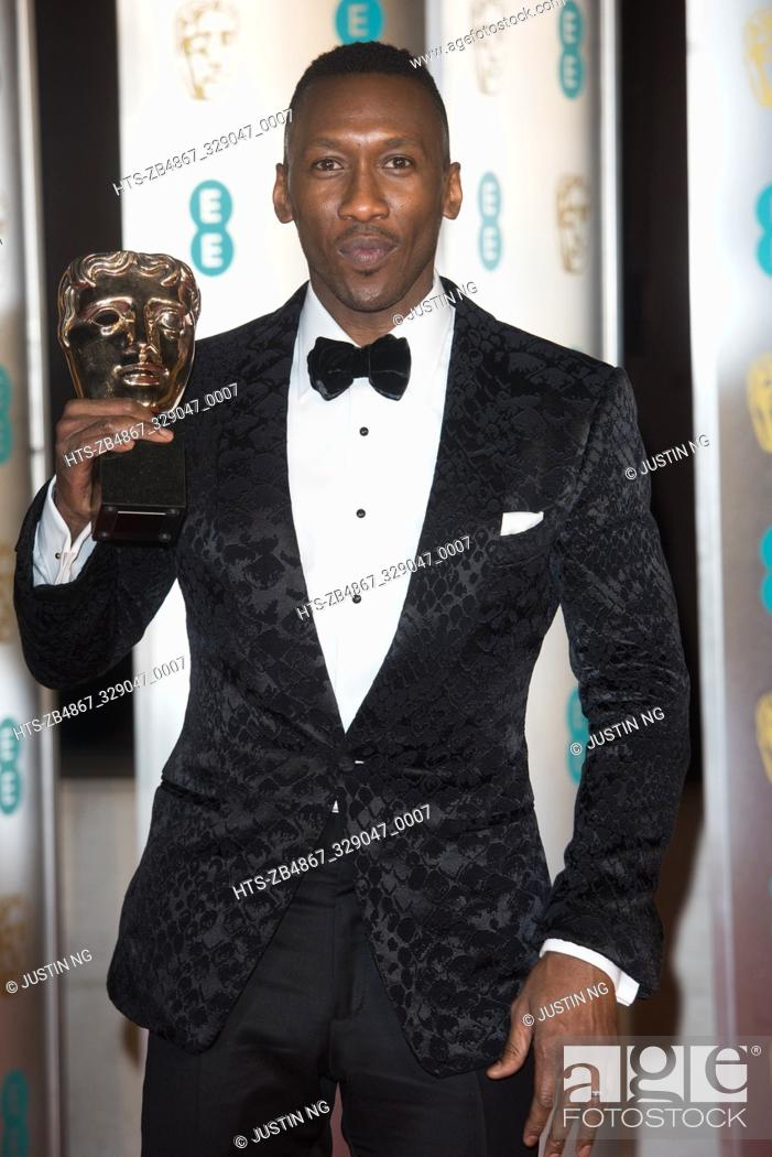 Stock Photo: Mahershala Ali with his Best Suppoting Actor BAFTA for 'Green Book' at the 72nd Annual EE British Academy Film Awards After-Party Dinner at Grosvenor House.