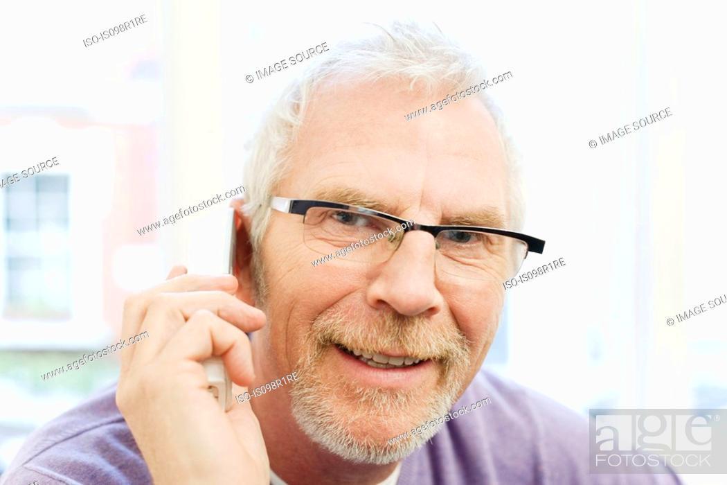 Stock Photo: Mature man using telephone.