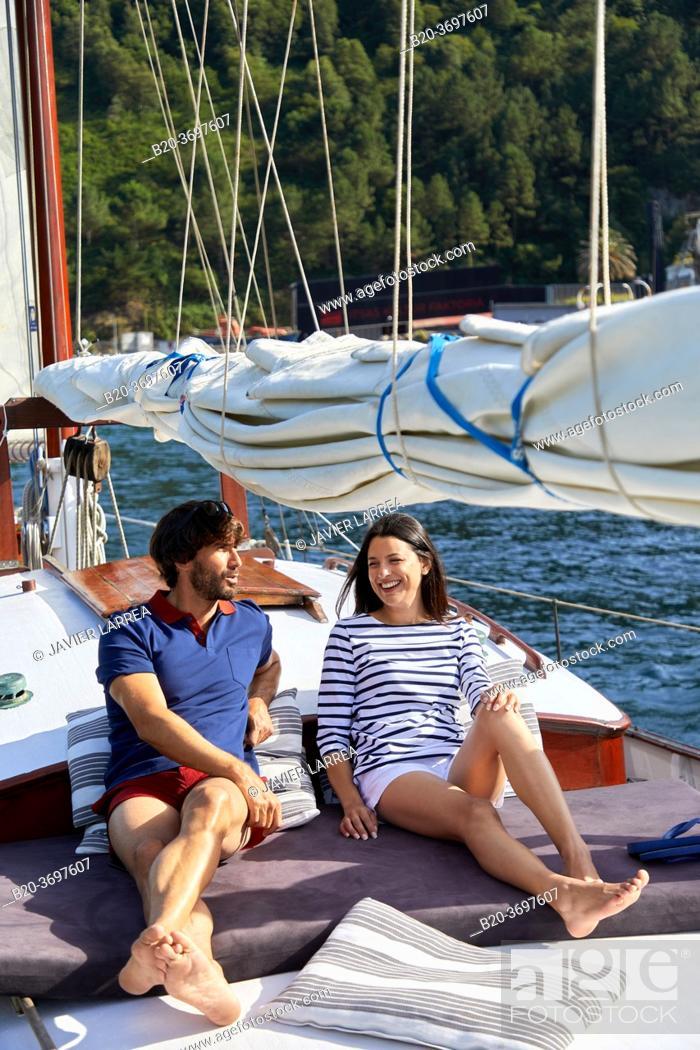 Stock Photo: Couple with sailor clothes, Sailboat, Port of Pasaia, Gipuzkoa, Basque Country, Spain, Europe.