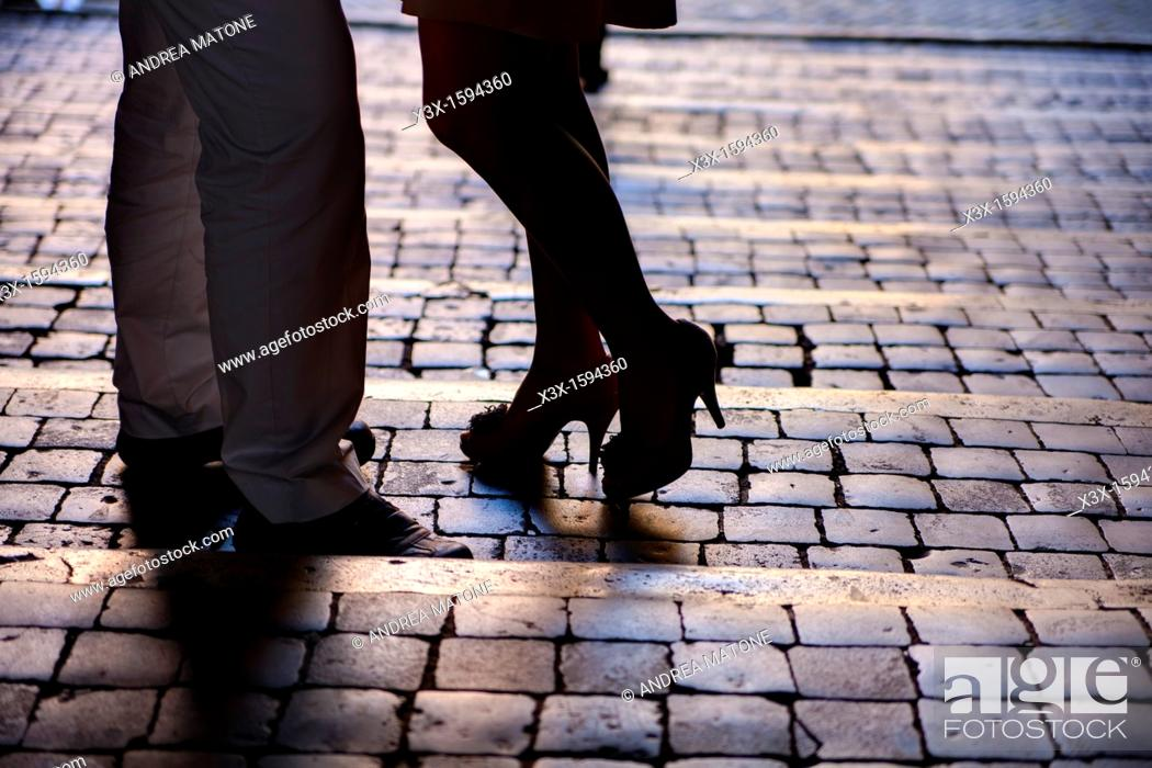 Stock Photo: Couple in Rome standing on cobble stones.