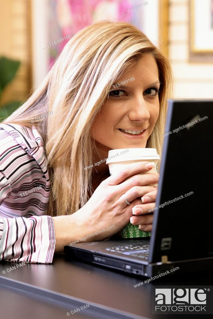 Stock Photo: Woman smiling using computer.