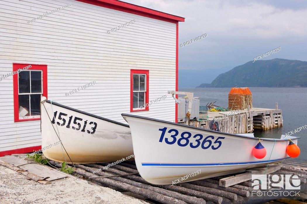 Stock Photo: Boats hauled out beside the Roberts Store a Historic Property in Woody Point, Gros Morne National Park, UNESCO World Heritage Site, Viking Trail.