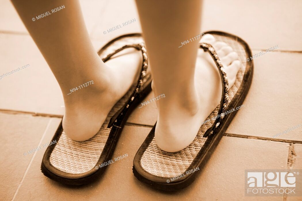 Stock Photo: Feet of a girl with shoes adult.