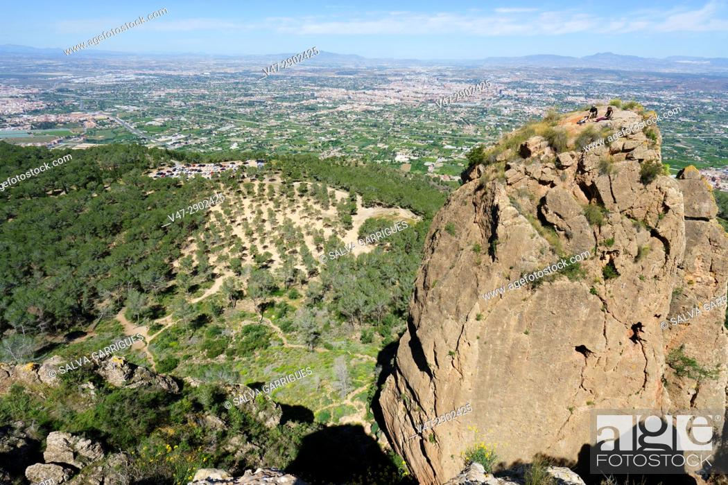 Stock Photo: The Cresta del Gallo, two young climbers at the top of the Panocha, Murcia, Spain.