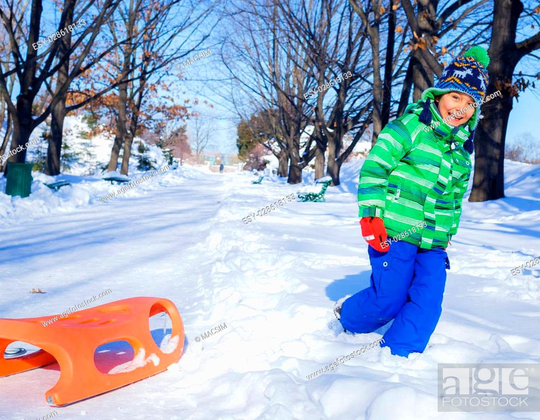 Christmas Vacation Sled.Little Boy Enjoying A Sleigh Ride Toddler Kid Riding A