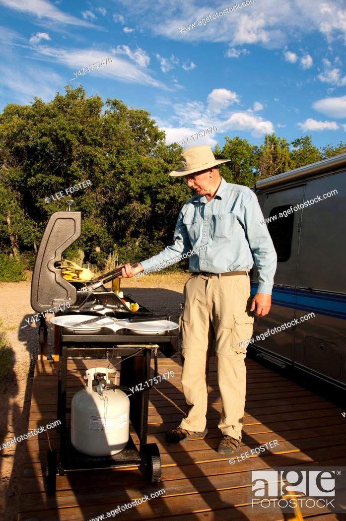Stock Photo: USA, Utah, grilling dinner at classic Airstream travel trailers available as lodging at the Shooting Star Drive-In in Escalante.