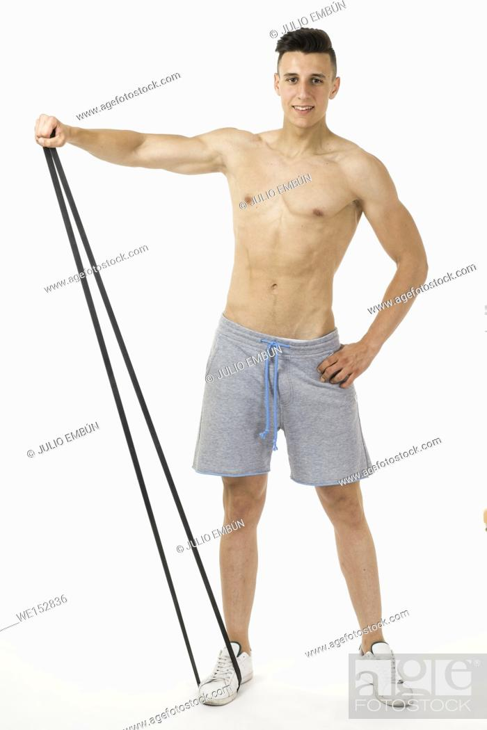 Stock Photo: Muscular young sportsman exercising on white background.