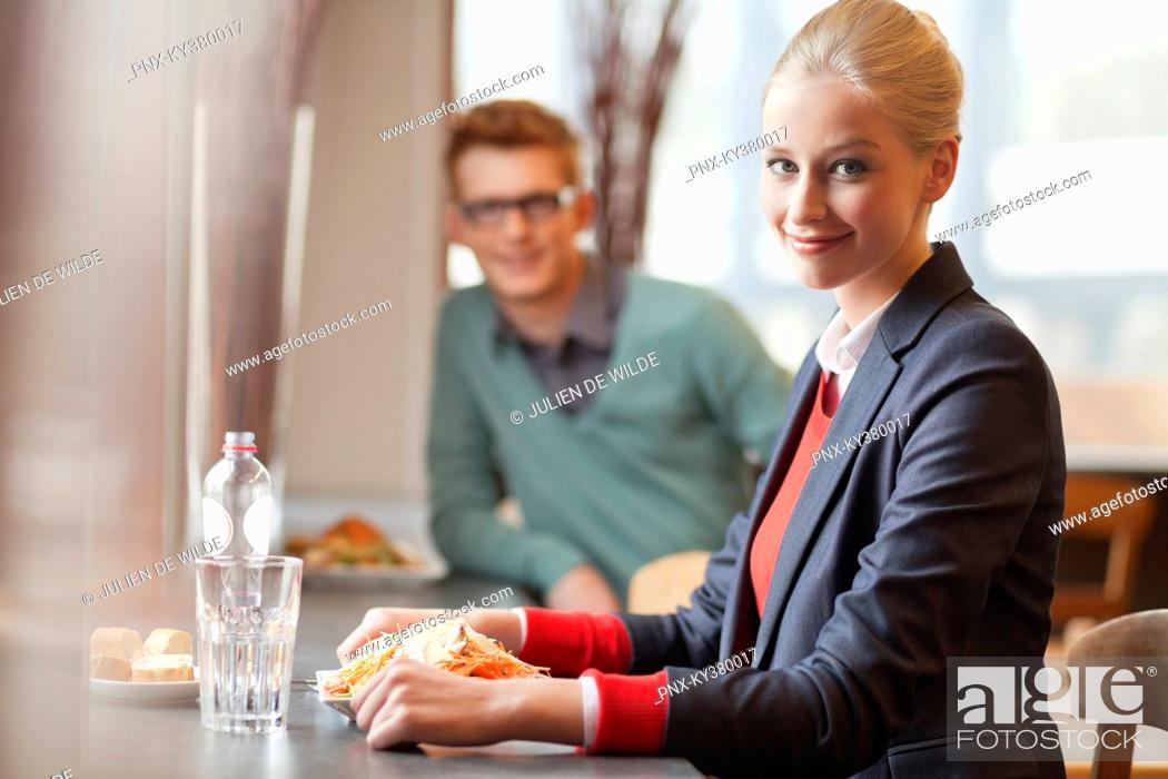 Stock Photo: Businesswoman having lunch in a restaurant.