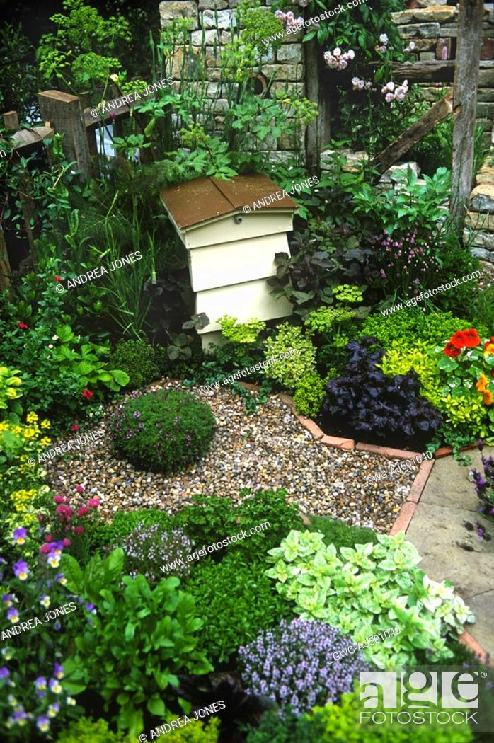 Stock Photo: BEE HIVE IN EDIBLE HERB GARDEN AT RHS CHELSEA FLOWER SHOW.  SMALL