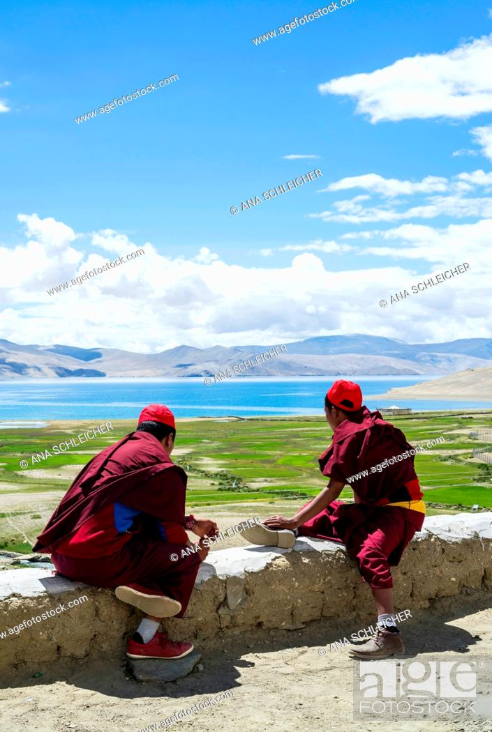 Stock Photo: Buddhist young monks watching the views. Nomad summer festival in Tso Moriri lake, Ladakh (India).