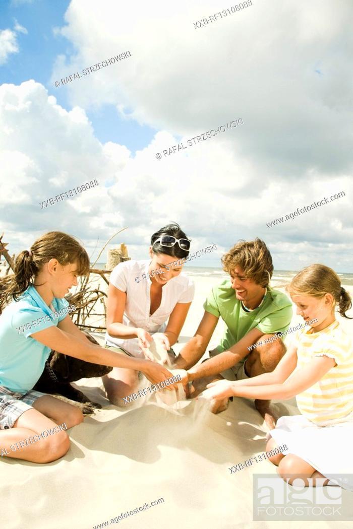 Stock Photo: kids building sand castle.
