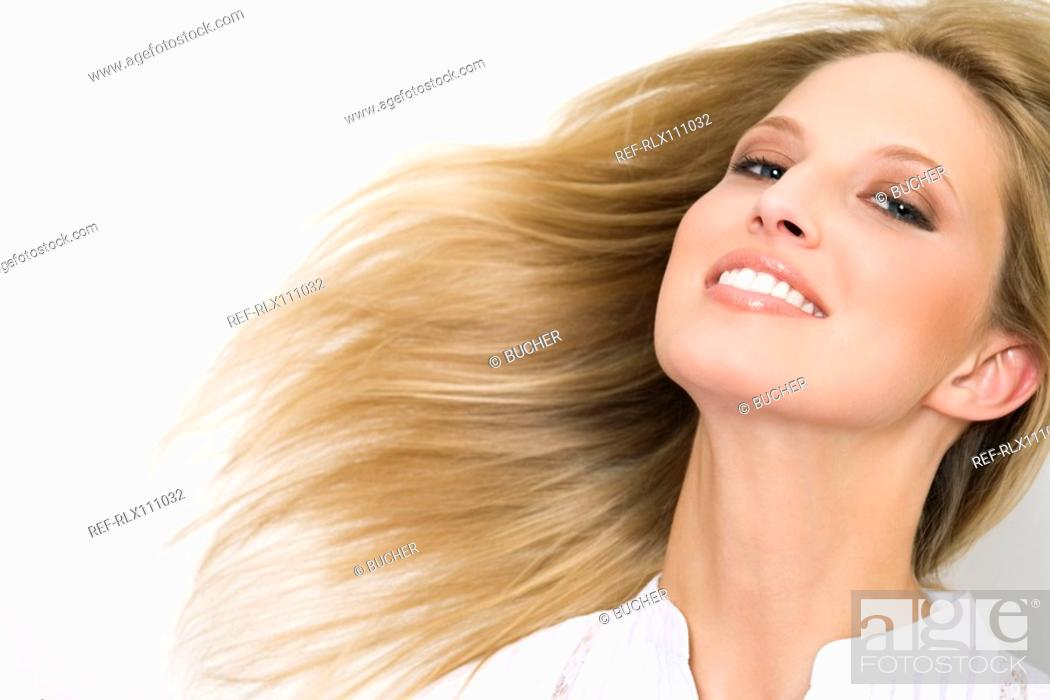 Stock Photo: Young woman with windswept hair.