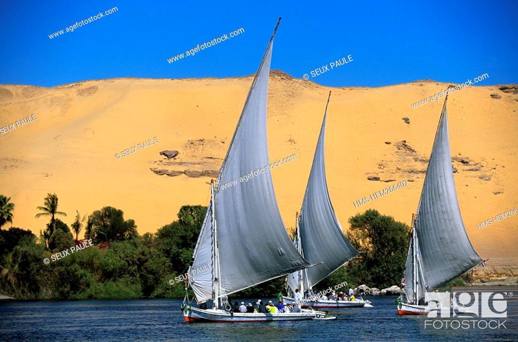 Stock Photo: Egypt, Upper Egypt, Nile Valley, Aswan, feluccas on Nile River.