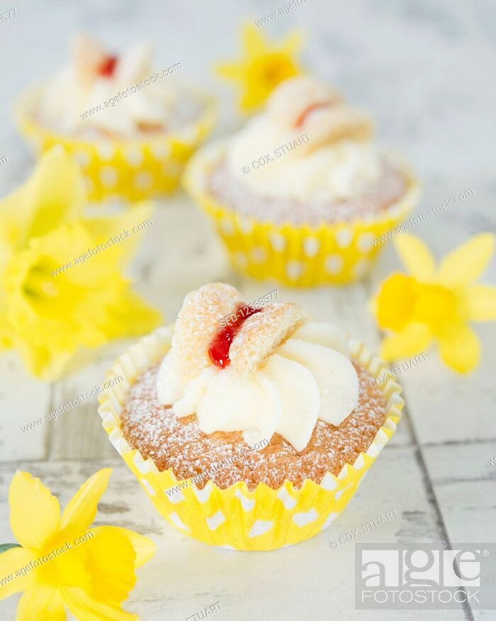 Stock Photo: Spring cupcakes with butterfly decoration.