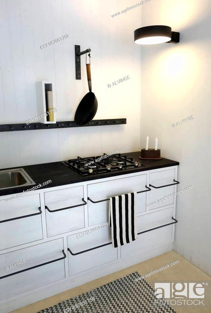 Stock Photo: Retro Kitchen in bright white colors. Minimalistic, sparse and contemporary interior design.