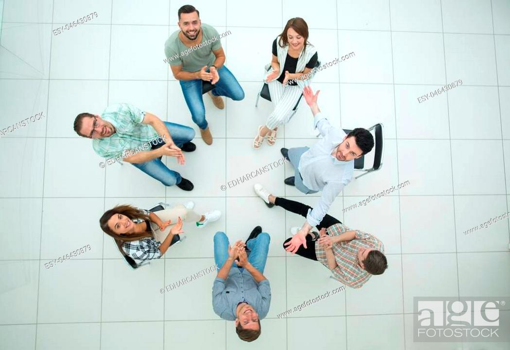 Photo de stock: top view.smiling business team applauds. success concept.