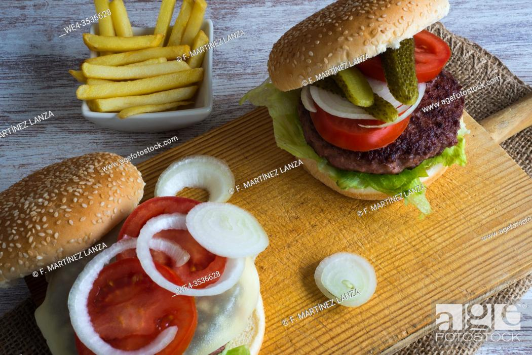 Stock Photo: Beef burger and fries.