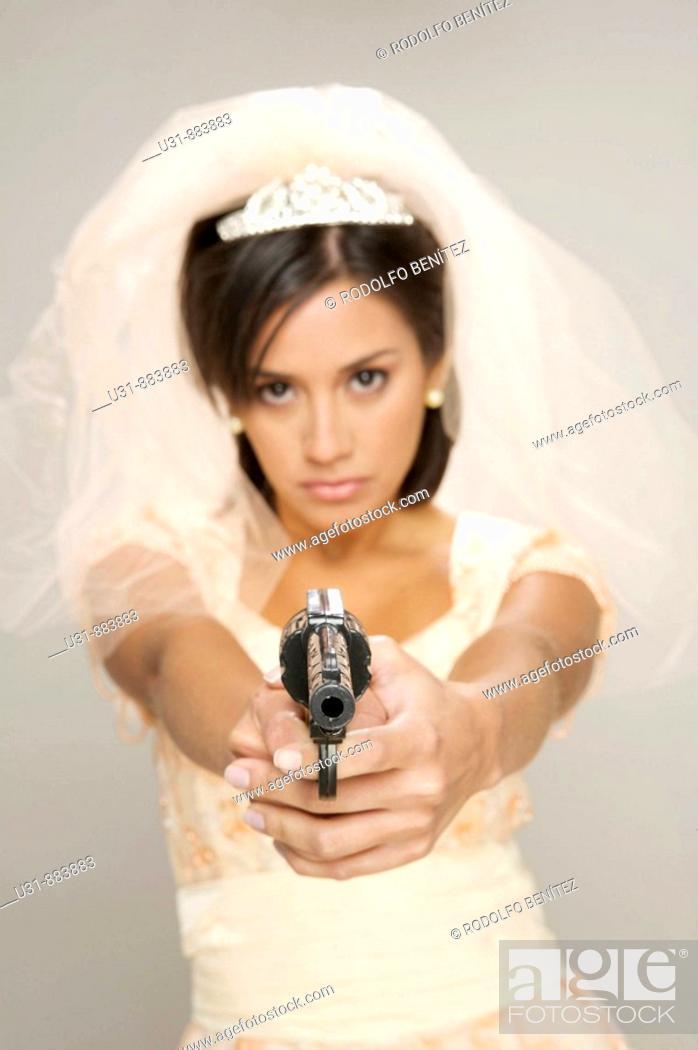 d3ca520d19c Stock Photo - Bride holding a gun