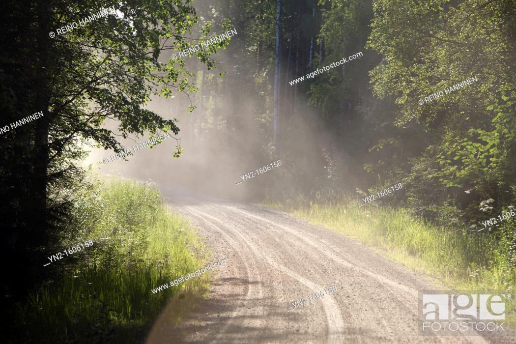 Stock Photo: Dust flying over dry dirt road  Location Suonenjoki Finland Scandinavia Europe.