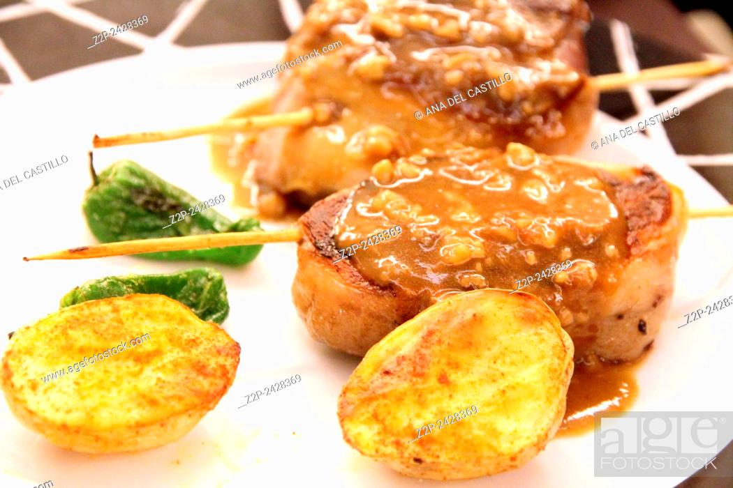 Stock Photo: Lamb meat with roasted potatoes on plate Spain.