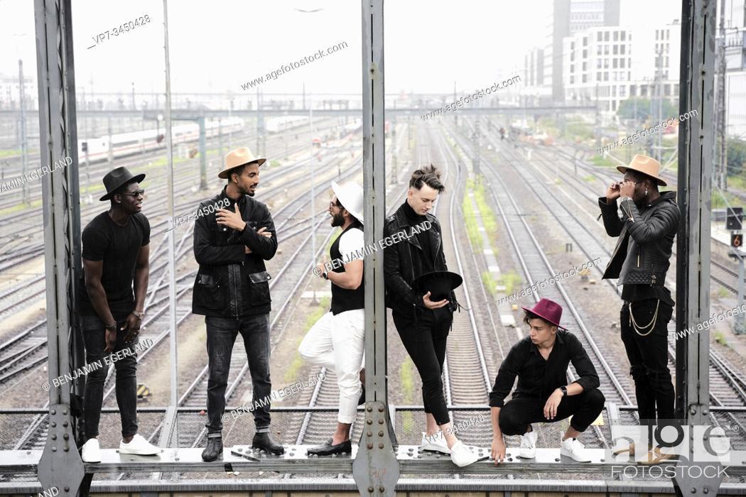 Imagen: Multiracial group of friends on bridge. Munich, Germany.