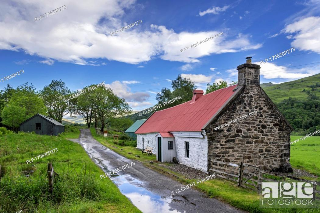 Stock Photo: 19th century Moirlanich Longhouse, cruck-framed lime-washed Scottish cottage with cattle byre in Glen Lochay near Killin, Stirling, Scotland, UK.