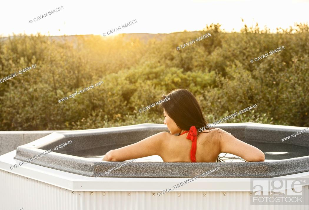 Stock Photo: Beautiful woman relaxing in hot tub at holiday villa in Iceland.